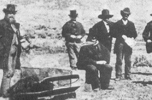 Close up of John D Lee sitting on his casket waiting to be executed
