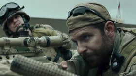 Bradley Cooper (Right) as Chris Kyle in American Sniper.