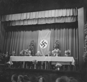 President Heber J Grant with the Swastika behind him at a regional meeting