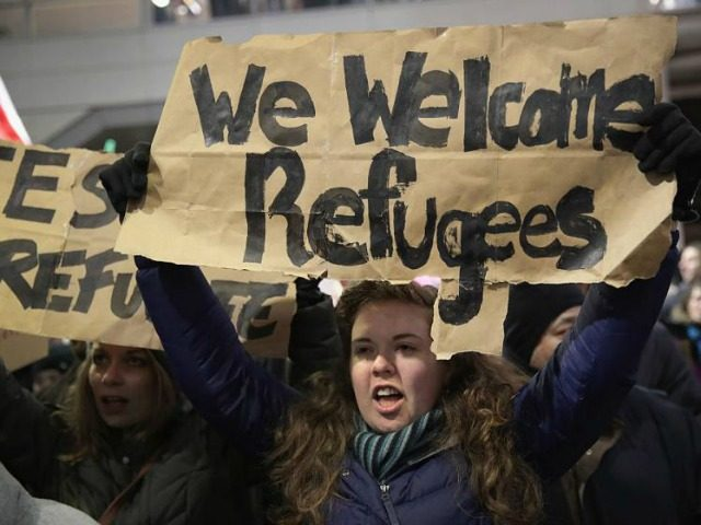 refugee-protesters-welcome-getty-640x480